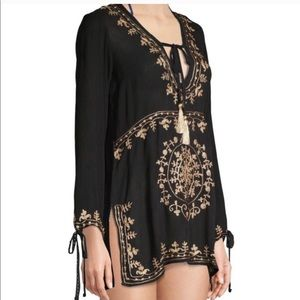 Rise & bloom long sleeve swim suit cover up.